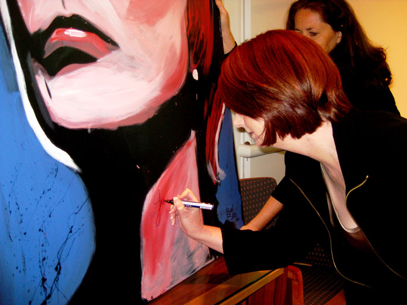 Prime Minister Julia Gillard signs her speed painting